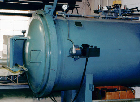 A 60 foot long autoclave is used to cure the epoxy